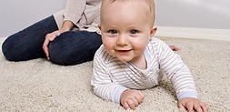 Carpet cleaning floor service with baby on the floor